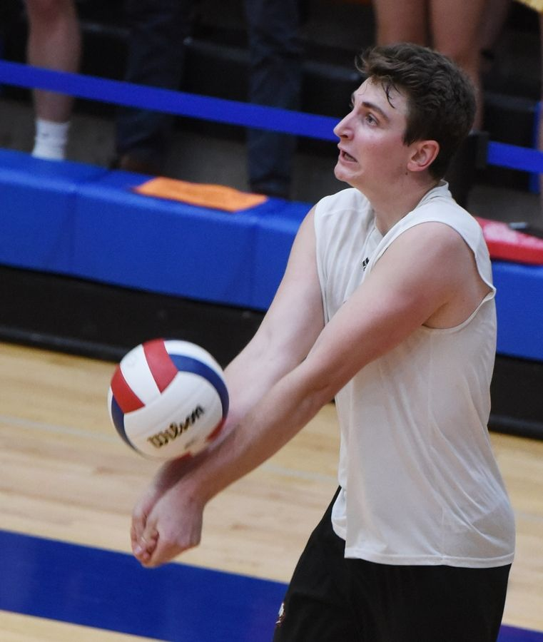 Barrington's Gabe Hartke gets a dig during the boys state volleyball semifinal at Hoffman Estates Friday.