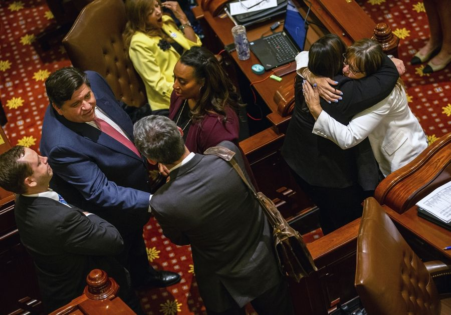 Illinois Gov. J.B. Pritzker, left, and Sen. Melinda Bush, right, D-Grayslake, celebrate passage by Senate of the Reproductive Health Act on Friday, May 31, 2019, in Springfield, Ill. The measure would rescind prohibitions on some late-term abortions and 45-year-old criminal penalties for performing the procedure. (Justin L. Fowler/The State Journal-Register]/The State Journal-Register via AP)