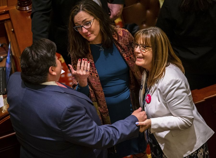 Illinois Gov. J.B. Pritzker is joined by Rep. Kelly Cassidy, center, D-Chicago, and Sen. Melinda Bush, right, D-Grayslake, as they celebrate Senate passage of the Reproductive Health Act, at the State Capitol on Friday, May 31, 2019, in Springfield, Ill. (Justin L. Fowler/The State Journal-Register via AP)