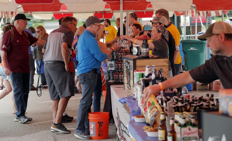 People sample brewers latest creations during the Grayslake Craft Beer Festival in downtown Grayslake Saturday.