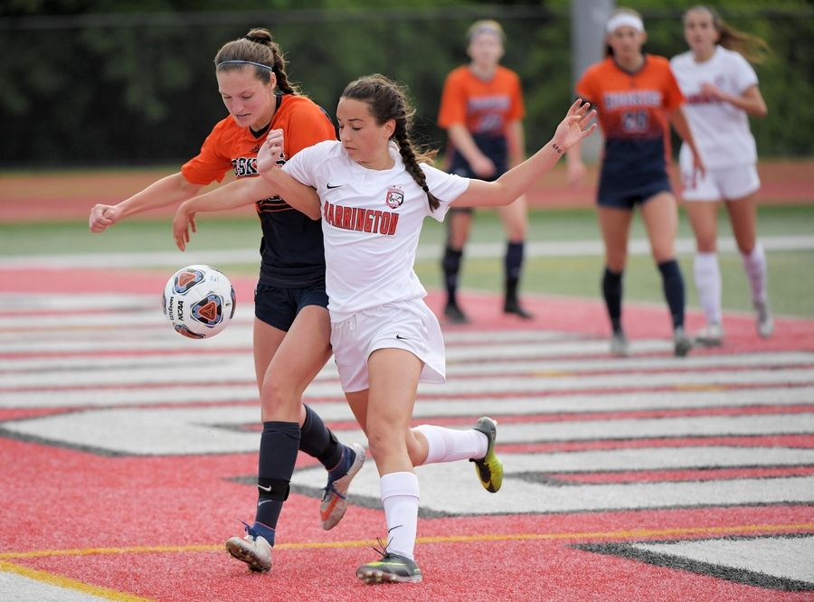 Naperville North's Kaitlyn Castillo keeps Barrington's Rebecca Shomaker from getting to the ball in the Class 2A state girls soccer final at North Central College in Naperville Saturday.