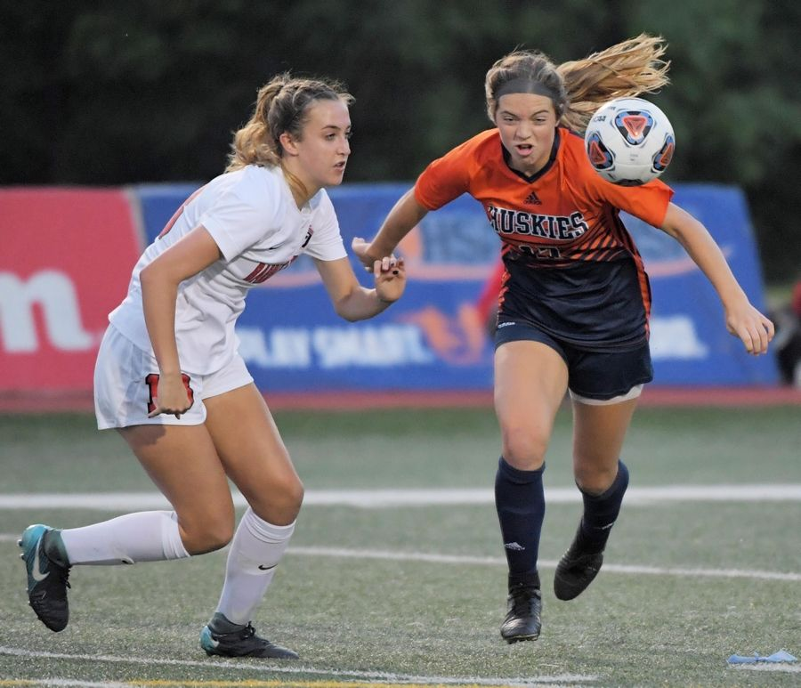 Barrington's Kate McGreevy and Naperville North's Hannah Martin battle for the ball in the Class 2A state girls soccer final at North Central College in Naperville Saturday.