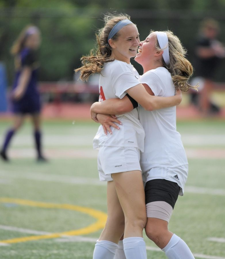 Benet Academy's Jaimee Cibulka and Mary Kate Hansen, right, celebrate Cibulka's overtime winning goal against Wauconda in the Class 2A state girls soccer final at North Central College in Naperville Saturday. Hansen also scored in the 2-1 win.