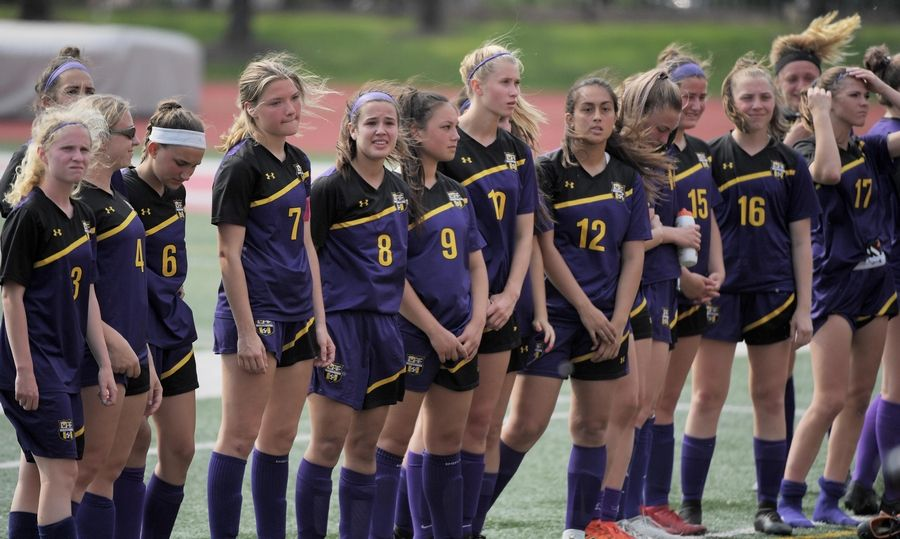 Wauconda waits for the medal ceremony after losing to Benet Academy in the Class 2A state girls soccer final at North Central College in Naperville Saturday.