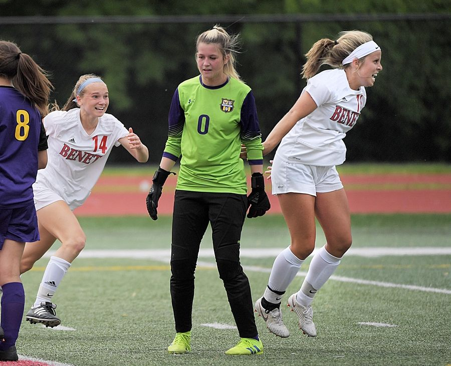 Benet Academy's Mary Kate Hansen, right, and teammate Jaimee Cibulka celebrate Hansen's goal as Wauconda goalkeeper Mackenzie Arden turns away in the Class 2A state girls soccer final at North Central College in Naperville Saturday.