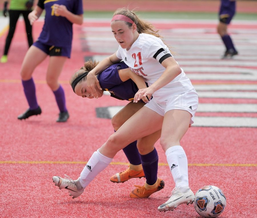 Benet Academy's Abby Casmere keeps Wauconda's Sarah Rizzo from the ball in the Class 2A state girls soccer final at North Central College in Naperville Saturday.