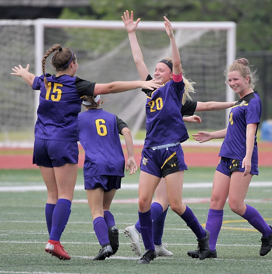 Wauconda's Abigail McHugh celebrates with teammates after her goal against Benet Academy in the Class 2A state girls soccer final at North Central College in Naperville Saturday.