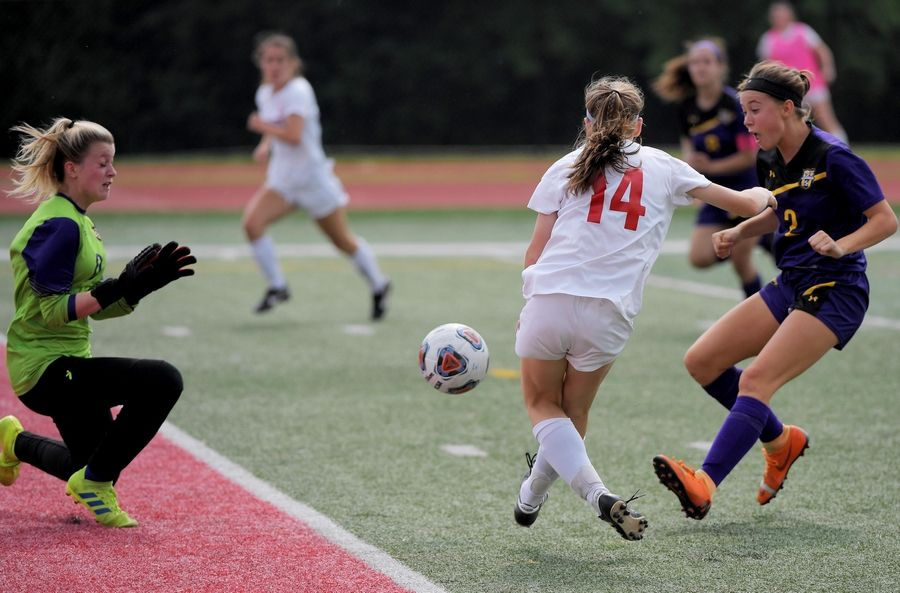 Benet Academy's Jaimee Cibulka sends the winning shot past Wauconda goalkeeper Mackenzie Arden in the Class 2A state girls soccer final at North Central College in Naperville Saturday.