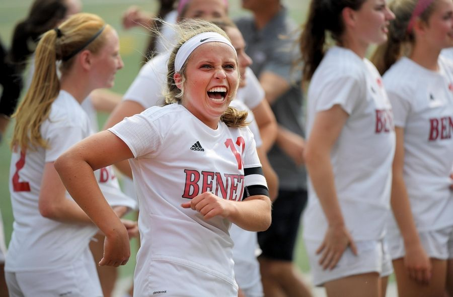 Benet Academy's Mary Kate Hansen smiles as she looks into the crowd after the Redwings defeated Wauconda in the Class 2A state girls soccer final at North Central College in Naperville Saturday.