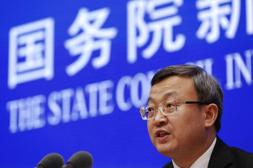"Chinese Vice Minister of Commerce Wang Shouwen speaks during a press conference about China-U.S. Trade issues at the State Council Information Office in Beijing, Sunday, June 2, 2019. China issued a report blaming the United States for a trade dispute and says it won't back down on ""major issues of principle."""