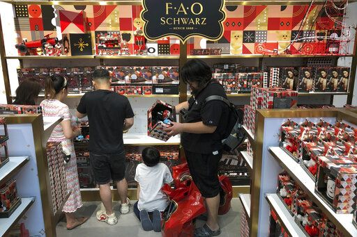 "In this Saturday, June 1, 2019, photo, Chinese shop for toys at the newly opened FAO Schwarz toy store at the capital city's popular shopping mall in Beijing. China issued a report Sunday blaming the United States for a trade dispute and says it won't back down on ""major issues of principle."""