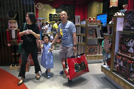 "In this Saturday, June 1, 2019, photo, Chinese buy toys at the newly open FAO Schwarz toy store at the capital city's popular shopping mall in Beijing. China has issued a report blaming the United States for a trade dispute and says it won't back down on ""major issues of principle."" The statement from the Cabinet spokesman's office on Sunday says China has kept its word throughout 11 rounds of talks and will honor its commitments if a trade agreement is reached."