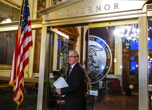 Illinois House Republican Leader Jim Durkin, R-Western Springs, exits the governor's office after meeting with Senate President John Cullerton, D-Chicago, and the governor as negotiations on the budget bill continued into the evening on the scheduled last day of the spring session, at the State Capitol, Friday, May 31, 2019, in Springfield, Ill. (Justin L. Fowler/The State Journal-Register via AP)