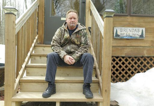 In this April 10, 2019 photo, Wayne Sankey sits on the front steps of his Lakewood, Wis. home where he is the neighbor of Raymand Vannieuwenhoven, who authorities say is the suspect in a cold-blooded 43-year-old cold case murder. The news of Vannieuwenhoven's arrest hit Sankey, 68, like a thunderbolt.   Prosecutors said they used DNA and genetic genealogy to connect Vannieuwenhoven to the 1976 killings of a young couple, David Schuldes and Ellen Matheys.