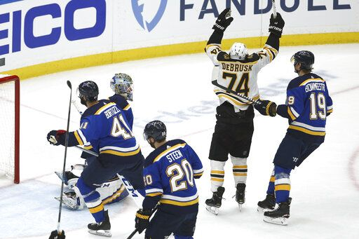 Boston Bruins left wing Jake DeBrusk (74) celebrates after teammate Patrice Bergeron, not shown, scored a goal against the St. Louis Blues during the first period of Game 3 of the NHL hockey Stanley Cup Final Saturday, June 1, 2019, in St. Louis.