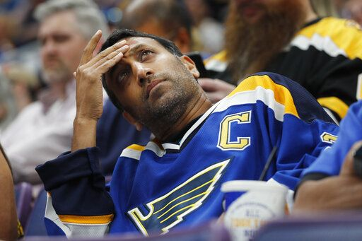 A St. Louis Blues fan looks at the scoreboard during the first period of Game 3 of the NHL hockey Stanley Cup Final between the Blues and the Boston Bruins Saturday, June 1, 2019, in St. Louis.