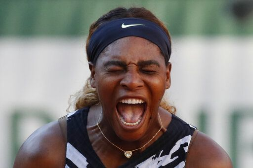 Serena Williams of the U.S. screams during her third round match of the French Open tennis tournament against Sofia Kenin of the U.S. at the Roland Garros stadium in Paris, Saturday, June 1, 2019.