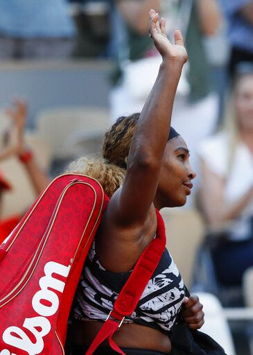 Serena Williams of the U.S. waves goodbye after losing her third round match of the French Open tennis tournament against Sofia Kenin of the U.S. in two sets, 2-6, 5-7, at the Roland Garros stadium in Paris, Saturday, June 1, 2019.