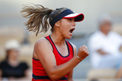 Sofia Kenin of the U.S. clenches his fist after scoring a point against Serena Williams of the U.S. in the last game of the second set during their third round match of the French Open tennis tournament at the Roland Garros stadium in Paris, Saturday, June 1, 2019.