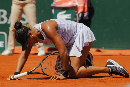 Japan's Naomi Osaka gets up after slipping during her third round match of the French Open tennis tournament against Katerina Siniakova of the Czech Republic at the Roland Garros stadium in Paris, Saturday, June 1, 2019. Osaka lost her match in two sets, 4-6, 2-6.