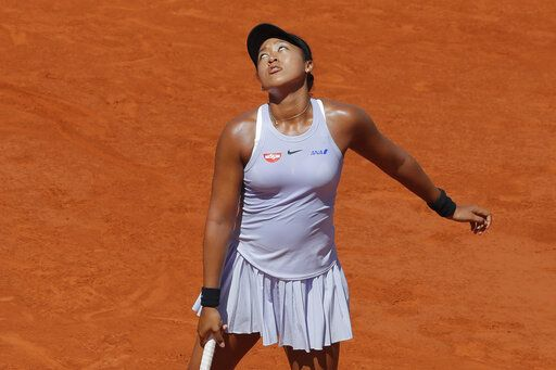 Japan's Naomi Osaka reacts when missing a point and losing the first set during her third round match of the French Open tennis tournament against Katerina Siniakova of the Czech Republic at the Roland Garros stadium in Paris, Saturday, June 1, 2019.