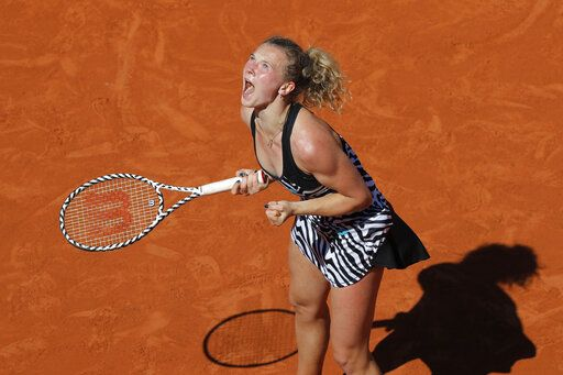 Katerina Siniakova of the Czech Republic celebrates winning her third round match of the French Open tennis tournament against Japan's Naomi Osaka in two sets, 6-4, 6-2, at the Roland Garros stadium in Paris, Saturday, June 1, 2019.