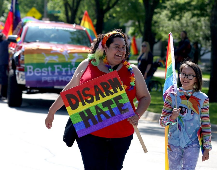 Erika Bachner of River Forest, left, and her daughter Zara, 11, march Sunday during the first Buffalo Grove Pride Parade.