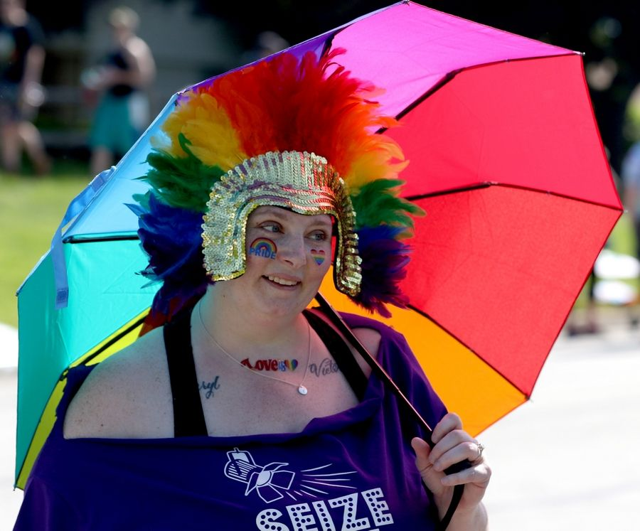 Danielle Grosche of Lake Zurich marches with the Seize the Stage group Sunday during the first Buffalo Grove Pride Parade.