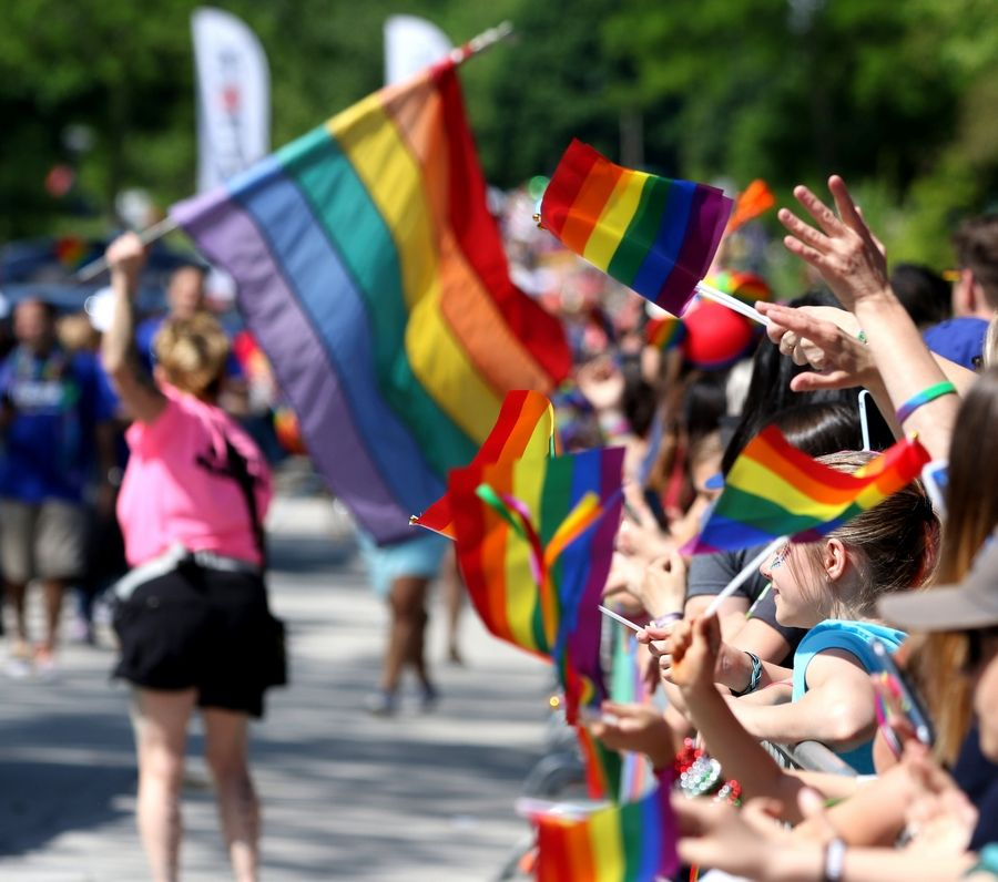 Paradegoers cheer on the marchers Sunday during the first Buffalo Grove Pride Parade.