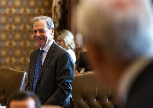 Illinois Senate President John Cullerton, D-Chicago, smiles as Illinois Sen. Terry Link, D-Vernon Hills, acknowledges the time he has spent trying to pass a gaming expansion bill on the floor of the Illinois Senate during overtime of the Spring Session at the Illinois State Capitol, Sunday, June 2, 2019, in Springfield, Ill. The Illinois Senate approved funding for the capital construction plan, legalized sports betting and gambling expansion. (Justin L. Fowler/The State Journal-Register via AP)