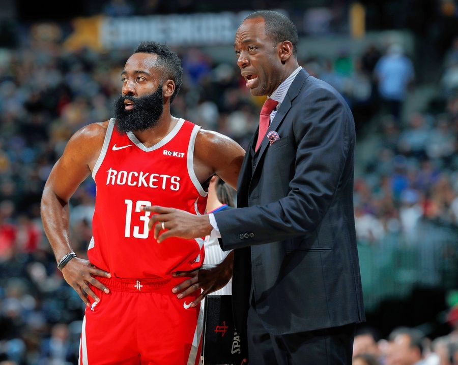 Houston Rockets guard James Harden, left, confers with assistant coach Roy Rogers during a break in the first half of an NBA basketball game against the Denver Nuggets, Tuesday, Nov. 13, 2018, in Denver.