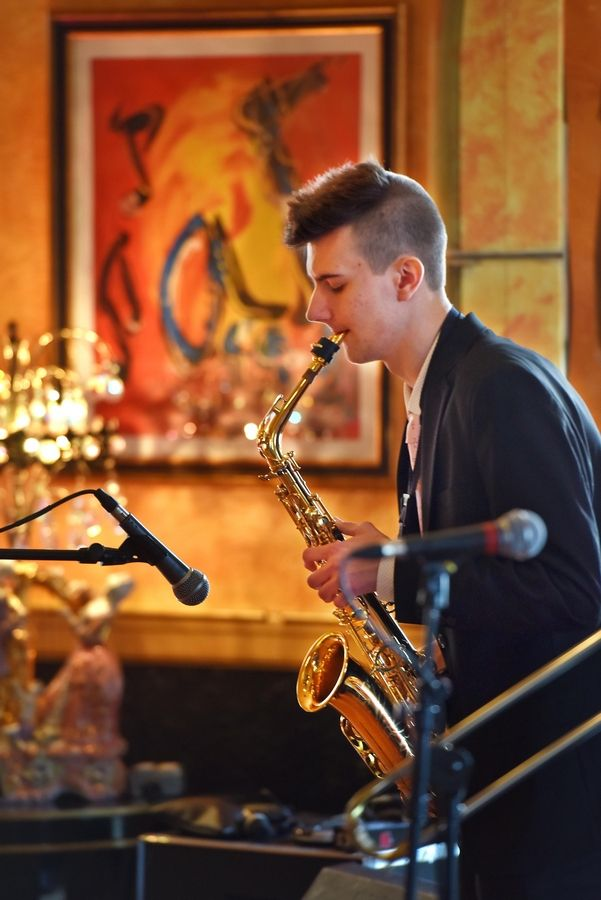 Jackson Kaprak of Prospect Heights plays his saxophone as part of the jazz combo JANNK during preliminary auditions for the eighth season of Suburban Chicago's Got Talent on Tuesday at the Arcada Theater in St. Charles.