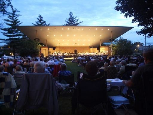 The Wheaton Municipal Band attracts a crowd of several thousand to Memorial Park for Thursday night concerts during its summer season.
