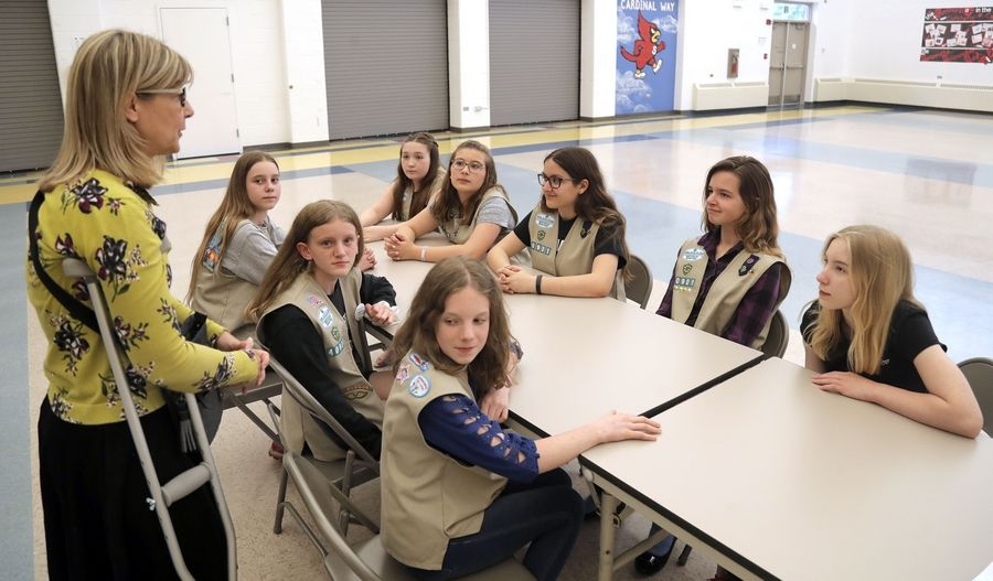 Girl Scout Troop 40901 leader Ellen Burkhardt leads a meeting with her troop at South School in Arlington Heights to go over their project of raising money for a bench to be installed at nearby Pioneer Park in memory of classmate Anna Hrtanek, who died in 2018.
