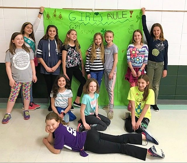 Anna Hrtanek of Arlington Heights, in purple shirt in front, is shown with her Girl Scout troop. Anna died in 2018 at age 11, but her troop mates keep her memory alive through fundraising projects.