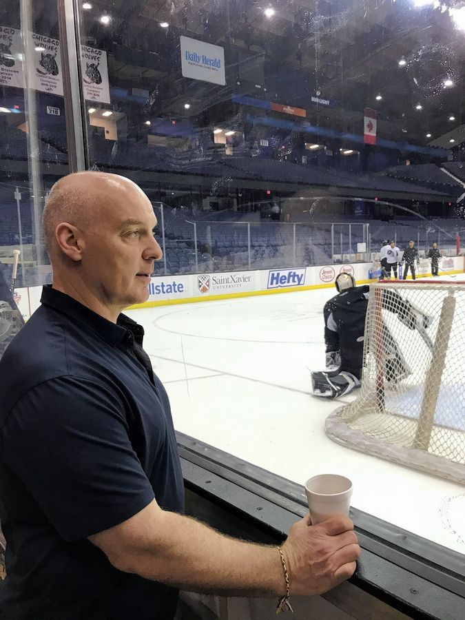 Chicago Wolves GM Wendell Young watches his team practice at the Allstate Arena Tuesday morning. The Wolves face Charlotte in Game 3 of the Calder Cup Finals Wednesday night at home, with the series tied at 1-1.