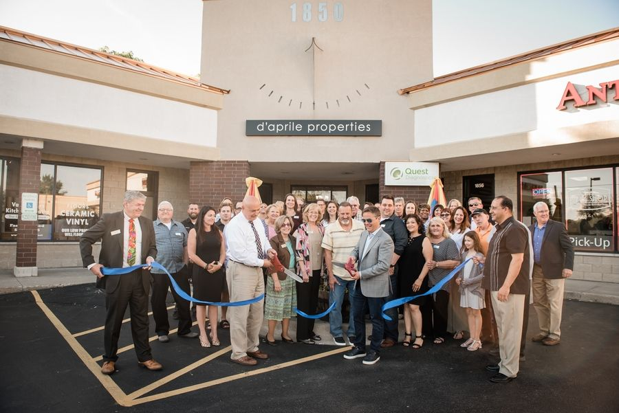 Lindenhurst Mayor Dominic Marturano and the Founder of d'aprile properties, Ryan D'Aprile, take part in a ribbon-cutting ceremony to officially open two new d'aprile properties locations, in Gurnee and Lindenhurst.Carol DeAnda