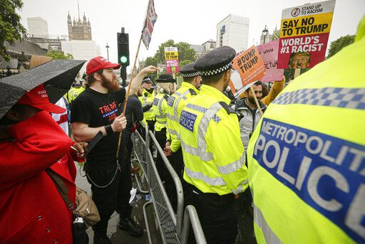 Pro and anti Donald Trump protesters are separated by a police line, in Parliament square in London, Tuesday, June 4, 2019. Trump will turn from pageantry to policy Tuesday as he joins British Prime Minister Theresa May for a day of talks likely to highlight fresh uncertainty in the allies' storied relationship.