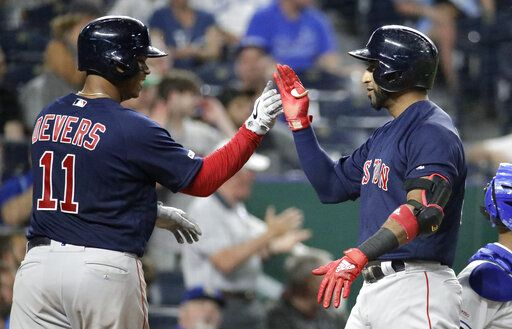 Boston Red Sox's Eduardo Nunez, right, celebrates with Rafael Devers (11) after hitting a three-run home run during the eighth inning of a baseball game against the Kansas City Royals Tuesday, June 4, 2019, in Kansas City, Mo.