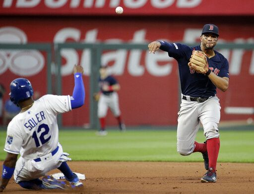 Boston Red Sox shortstop Xander Bogaerts throws to first for the double play hit into by Kansas City Royals' Kelvin Gutierrez after forcing Jorge Soler out at second to end the fourth inning of a baseball game Tuesday, June 4, 2019, in Kansas City, Mo.
