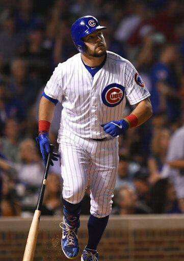 Chicago Cubs' Kyle Schwarber watches his solo home run during the fifth inning of a baseball game against the Colorado Rockies Tuesday, June 4, 2019, in Chicago.