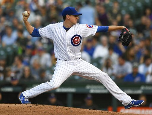 Chicago Cubs starter Kyle Hendricks delivers a pitch during the first inning of a baseball game against the Colorado Rockies Tuesday, June 4, 2019, in Chicago.