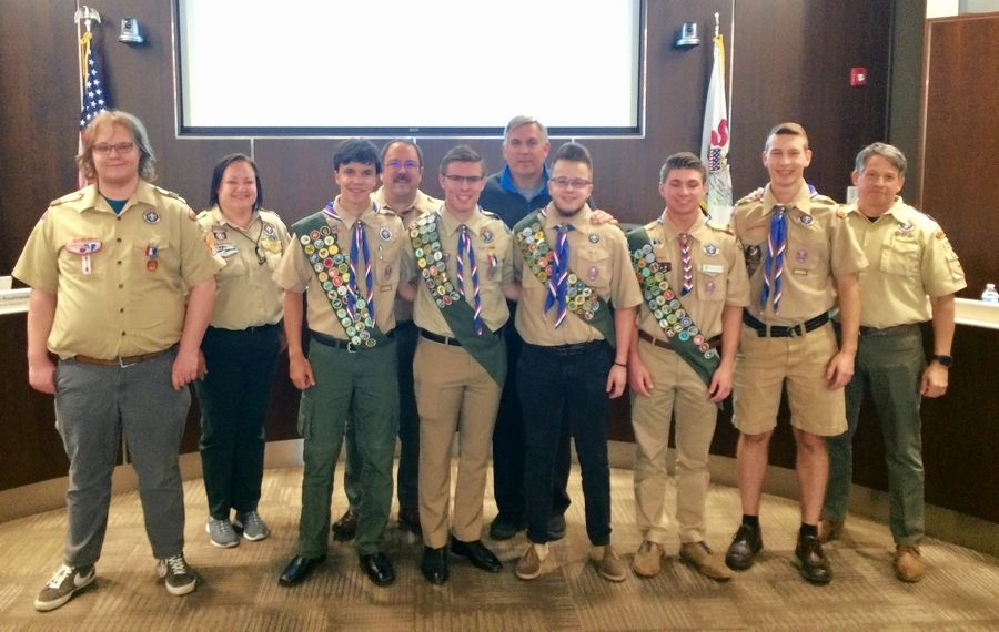 Palatine Mayor Jim Schwantz, middle rear, gathers with Eagle Scouts who were honored at this week's village council meeting for achieving the prestigious rank.