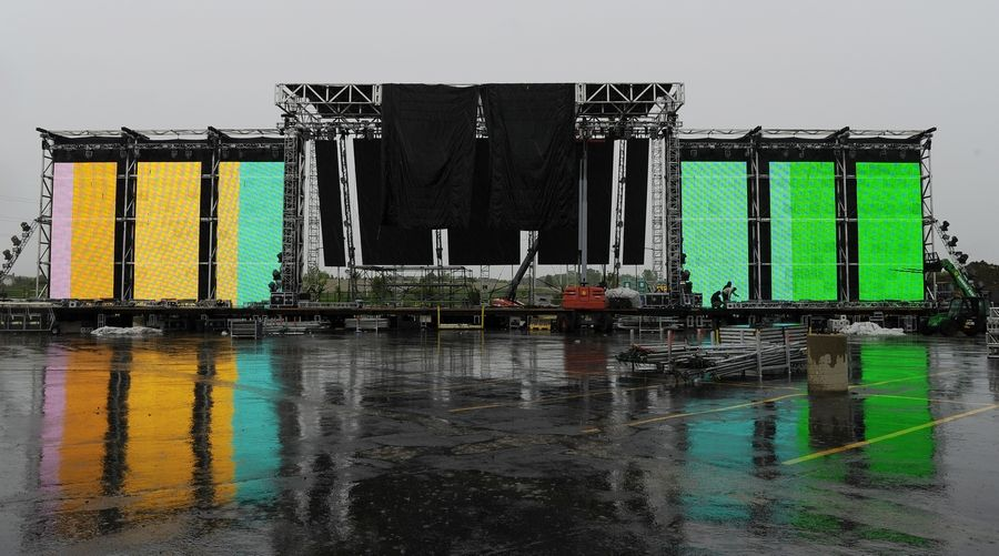 Crews set up stages Tuesday outside the Sears Centre Arena in Hoffman Estates for the Spring Awakening electronic music festival, which begins Friday. Officials estimate crowds between 25,000 and 30,000 each day of the three-day fest.