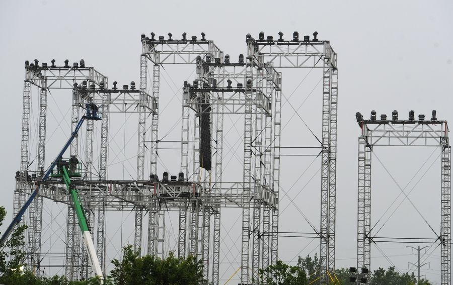 Crews set up scaffolding Tuesday for the main stage for the Spring Awakening electronic music festival, which begins Friday outside the Sears Centre Arena in Hoffman Estates. Officials estimate crowds between 25,000 and 30,000 each day of the three-day fest.