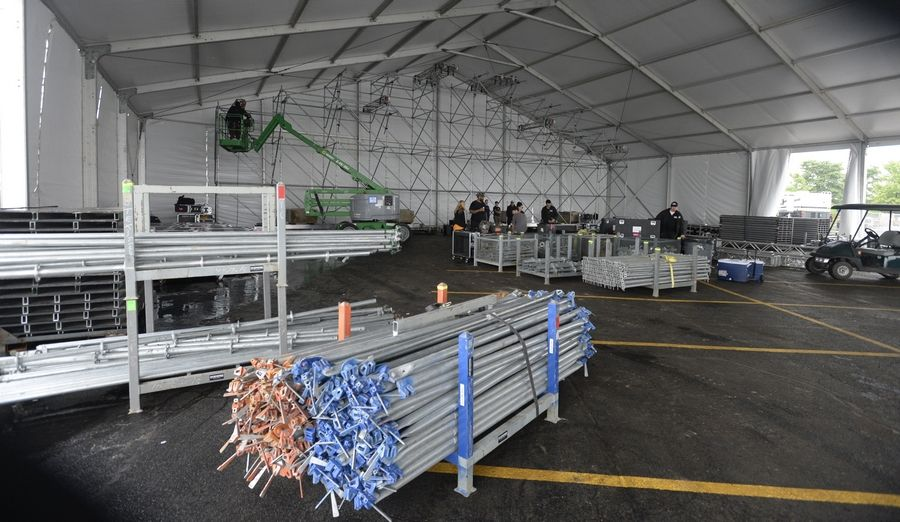 Work continued Tuesday outside the Sears Centre Arena in Hoffman Estates in preparation for the three-day Spring Awakening electronic music festival.