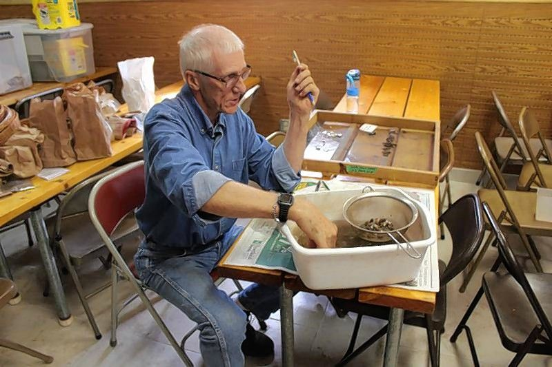 Volunteers first learn identification of artifacts by cleaning and sorting during the archaeological research program at Garfield Farm Museum in Campton Hills.