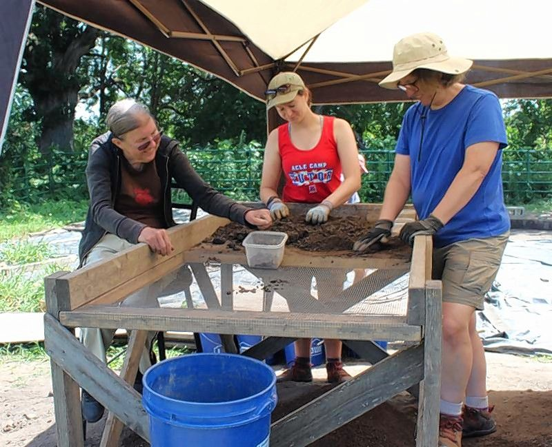 In the field, volunteers are taught how to screen and look for artifacts at Garfield Farm Museum's archaeological research program.