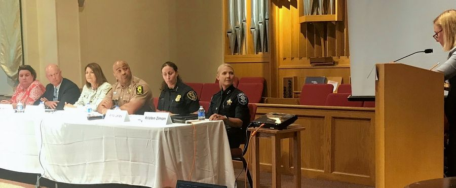 Left to right, state Rep. Kathleen Willis, Kane County State's Attorney Joe McMahon, state police FOID division bureau chief Jessica Trame, state police Assistant Deputy Director Lt. Col. David Byrd, Elgin Police Chief Ana Lalley, Aurora Police Chief Kristen Ziman and state Rep. Anna Moeller, at the podium at First Presbyterian Church in Elgin, discuss what can be done in the aftermath of the Pratt Co. shooting that left five dead in Aurora.