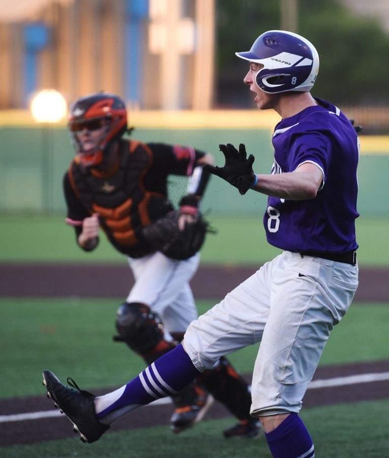 Hampshire's Andrew Krajecki tries to show that he was safe, but he was called out at the plate during the Class 4A state baseball semifinal game against Edwardsville in Joliet Friday.